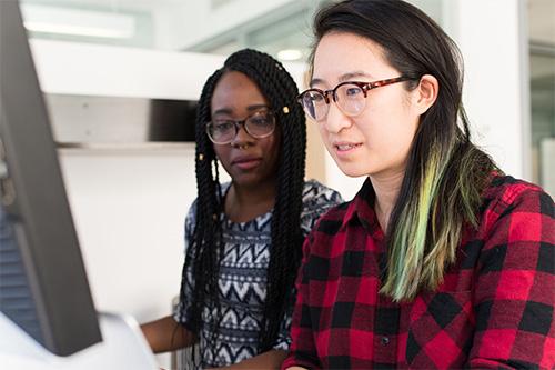 Two women debugging